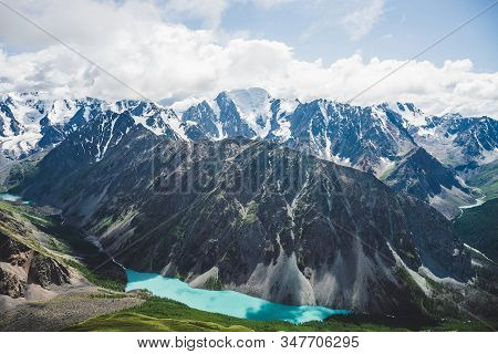 Spectacular View To Scenic Valley With Big Beautiful Mountain Lake Surrounded By Giant Snowy Ranges