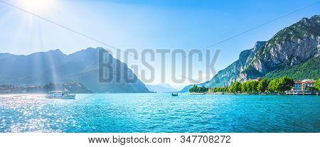Lecco Town In Como Lake District And Ferry Boat. Italian Travel Destinatio. Italy, Europe.
