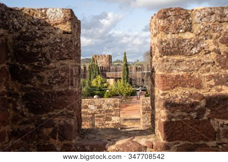 Unique Angle And Perspective Looking Through The Rampart Stone Walls Of Castelo De Silves (silves Ca
