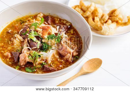 Northern Thai Food (kanom Jeen Nam Ngeaw), Rice Noodles With Spicy Soup In A Bowl Eating With Pork R