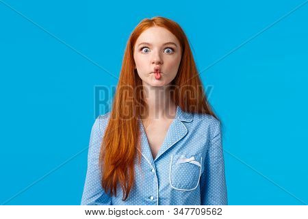 Silent Like Fish. Cute And Funny Young Redhead Female With Long Ginger Hair, Sucking Lips As Mimicki