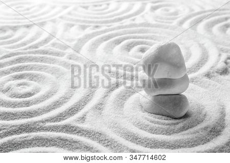 Stack Of White Stones On Sand With Pattern, Space For Text. Zen, Meditation, Harmony