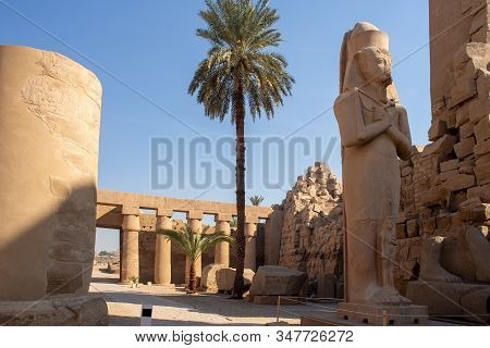 Luxor, The Temple Of Karnak, The Statue Of Ramses Ii And His Daughter Merit-amon.