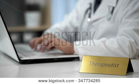 Therapeutist Filling Out Medical Forms, Prescribing Medication To Patient