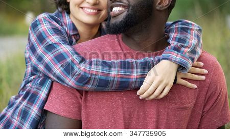 Close-up Of Thrilled Boyfriend And Girlfriend Demonstrating Shining White Teeth