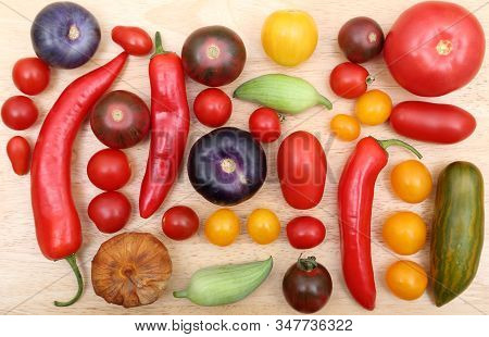 Colorful Tomatoes, Peppers And Tomatillo On Wooden Board.