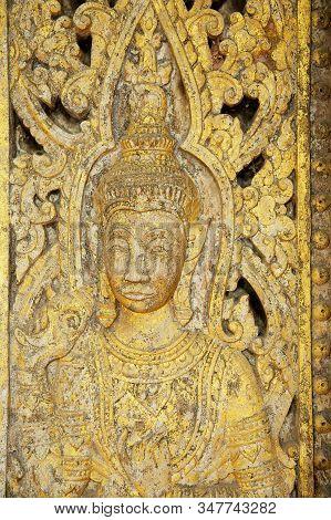 Luang Prabang, Laos - April 14, 2012: Elaborate Wood Carved Wooden Door At Wat Pa Huak Temple In Lua