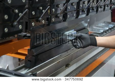 Operation Of Press Brake Hydraulic Bending Machine With Forming Die By Skill Operator. The Sheet Met