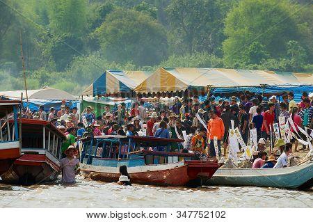 Luang Prabang, Laos - April 13, 2012: People Celebrate Lao New Year (phi Mai) At The Mekong River Ba