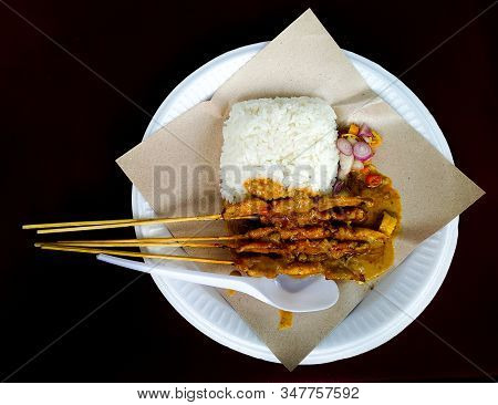 Chicken Satay - Chicken Satay With Rice On A Plate With A Black Background, Isolated Chicken Satay