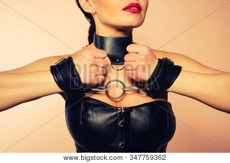 Submissive Girl In Leather Black Corset, Handcuffs And Collar Waiting For Punishment. - Image Toned