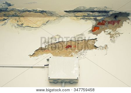 Damage Ceiling From Water Pipelines Leakage. Housing Problem Concept - Image Toned