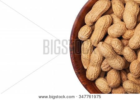 Peanuts In Shells Inside Round Wooden Bowl Isolated On White. Helathy Vegetarian Diet Food Backgroun