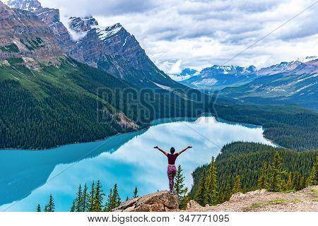 Woman Enjoying The Beautiful View Of Peyto Lake Alberta Canada