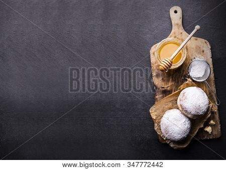 Donuts Covered With Powdered Sugar On The Black Stony Countertop. Banner With Sweet Pastries And A C