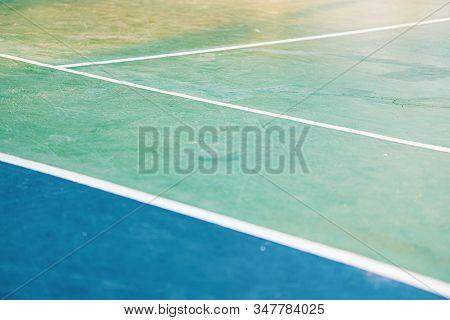 Green, Blue And White Lines On The Surface Of Tennis Court