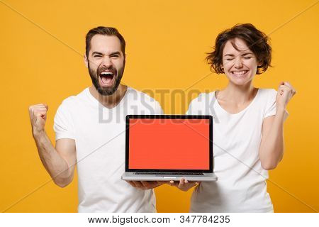 Happy Couple Friends Bearded Guy Girl In White T-shirts Isolated On Yellow Orange Background. People