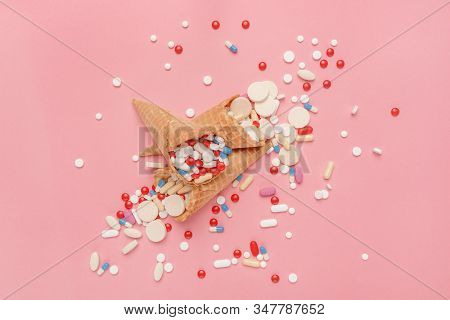 Pills Tablets And Capsules In Ice Cream Cones, Drug Abuse And Overuse Concept, Flat Lay Top View.