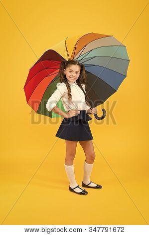 Accessory Making Walk To School Through The Rain Safer. Small Child Holding Colorful Umbrella Rain A