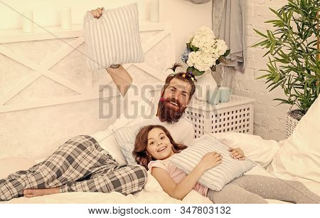 Man Bearded Hipster With Childish Hairstyle Colorful Ponytails And Daughter In Pajamas. Guy And Girl