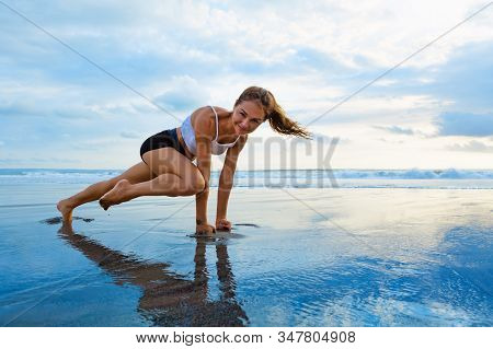 Sporty Woman Doing Mountain Climber Exercise - Run In Plank To Burn Fat. Sunset Beach, Blue Sky Back