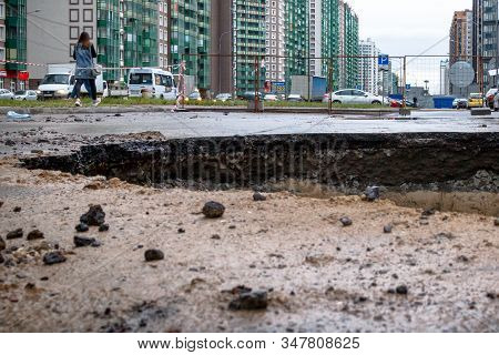 Saint Petersburg, Russia - June 2019: Hole In The Road, The Asphalt Collapsed, Because Of The Ground