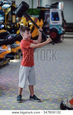 Technology, Gaming, Entertainment And People Concept. Boy Playing Automatic Toy Hummer On Playground