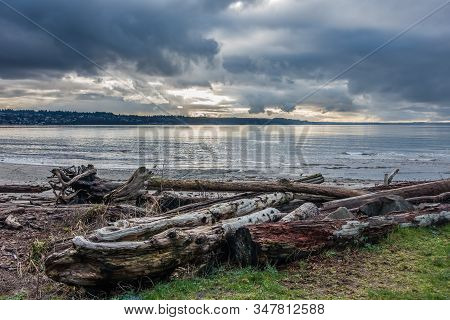 Dark Clouds Hang Over Smooth Water Of The Puget Sound.