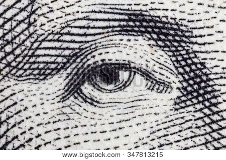 Macro close up photograph of George Washington eye on the US one dollar bill.