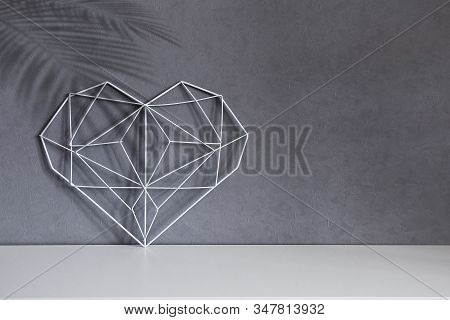 Home Decorative Frame In The Form Of A Heart On A Background Of Gray Wall, Interior. Concept Symbol