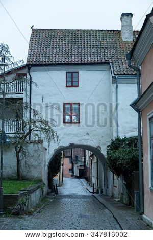 Arch In Street With House In Visby, Gotland.