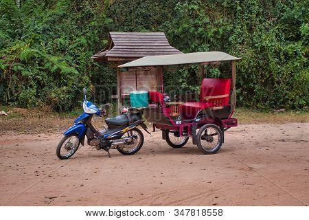 Siem Reap, Cambodia, 12.18.2019: A Parking Traditional Motorbike Tuk Tuk Taxi, A Popular Transportat