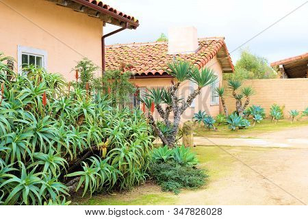 Spanish Style Adobe Hacienda Including A Spacious Courtyard With Aloe And Yucca Plants Taken In A Dr