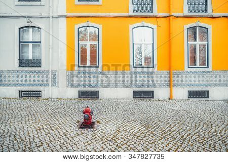 The Multicolored Facade Of An Old Traditional Residential Building In Lisbon; View Of The Colorful F
