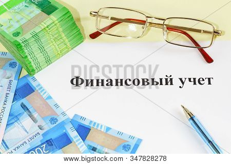 Systematic Accounting Of Income And Expenses In Monetary Terms. Money, Pen, Glasses And The Inscript
