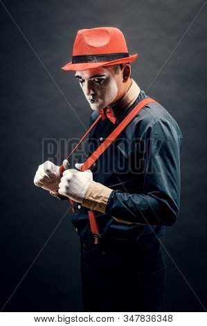 A Mime Artist Performs On Stage. Actor Of Pantomime Theatre. The Actor Of Drama Theatre And Mime. Pe