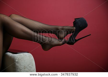 Beautiful Sexy Woman Legs Dangling Black High Heel Shoe Close Up