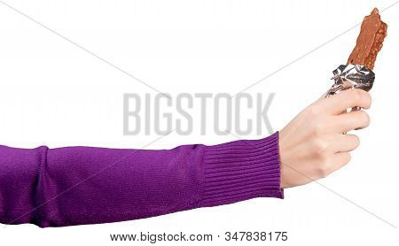 Womans Hand In A Bright Purple Sweatshirt Holds An Open Chocolate Bar. Isolated