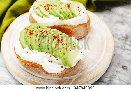 Two Avocado Toasts, Avocado Sandwich. Fresh Avocado Sliced On Toast Of Wheat Bread, Cream Cheese. Av