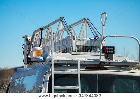 A Close Up And Detailed View Of The Operating Equipment Atop A Mobile Works Van, Amber Light And Sci