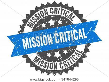 Mission Critical Grunge Stamp With Blue Band. Mission Critical