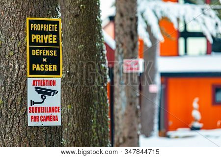 A Close Up Selective Focus View Of French Canadian Private Property Surveillance Camera Warning Sign