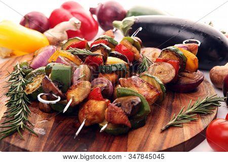 Grilled Pork Shish Or Kebab On Skewers With Vegetables . Food Background Shashlik