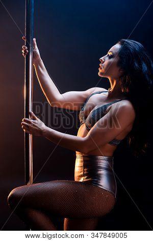 Side View Of Beautiful Stripper In Underwear Dancing Striptease Near Pylon On Blue