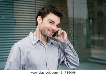 Portrait Of A Young Businessman On The Phone