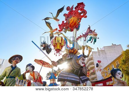 DENIA, VALENCIAN COMMUNITY, SPAIN - MARCH 18, 2017:  Fallas is a popular fest of Valencia and province where artists  create cardboard cartoon sculptures of popular subjects that burn in March 19