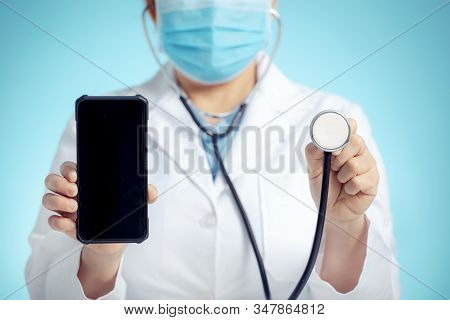 Doctor With Stethoscope And Smart Phone In Hand For Medical Exam Concepts