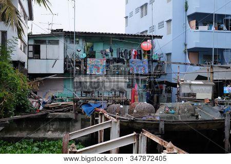 Bangkok, Thailand, December 28, 2018. Beggarly Dilapidated Shack In The Asian Metropolis. Modern Asi