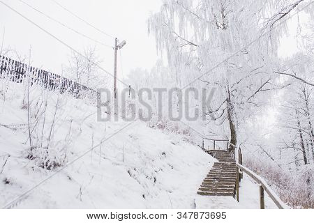 Snow Fall In Winter. Slippery Stair In Snow Outdoors Background. Magic Landscape With White Trees. S