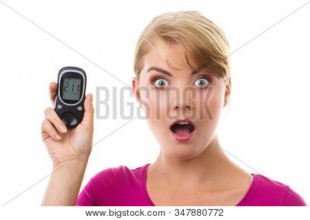 Shocked And Worry Woman Holding Glucometer With Bad Result Of Measurement Sugar Level